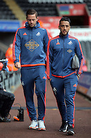 L-R Gylfi Sigurdsson and Neil Taylor of Swansea arrive before the Barclays Premier League match between Swansea City and Chelsea at the Liberty Stadium, Swansea on April 9th 2016
