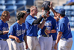 The Wildcats celebrate with Corey Pool after he hit a two-run homer against the College of Southern Idaho at Western Nevada College in Carson City, Nev., on Wednesday, Feb. 25, 2015. <br /> Photo by Cathleen Allison/Nevada Photo Source