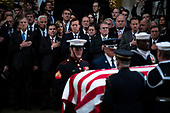 WASHINGTON, DC - DECEMBER 3 : Members of Congress watch as former president George H.W. Bush is carried in by Military Honor Guard as he arrives to lie in State at the U.S. Capitol Rotunda on Capitol Hill on Monday, Dec. 03, 2018 in Washington, DC. (Photo by Jabin Botsford/Pool)