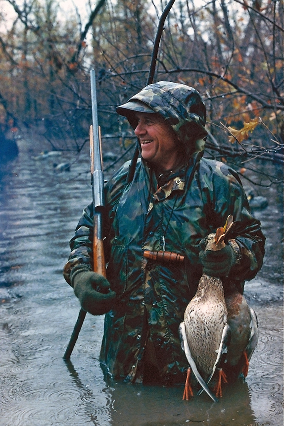 Duck hunter on rainy day with ducks, Poor Boy Club, Humnoke, Arkansas