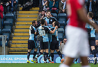 Max Kretzschmar of Wycombe Wanderers celebrates his goal with teammates during the Sky Bet League 2 match between Wycombe Wanderers and Crawley Town at Adams Park, High Wycombe, England on 28 December 2015. Photo by Andy Rowland / PRiME Media Images