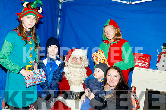 Santa with his elfs Shauna Reidy and Ava Fitzmaurice given presents to Keagan,Josephine and Davin O'Brien on his visit to Castleisland on Friday