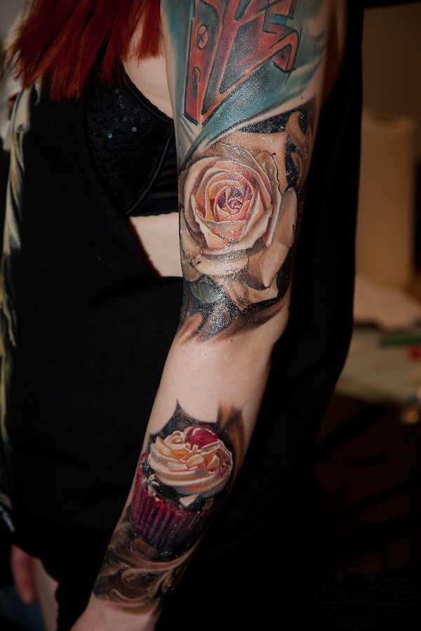 Copenhagen Inkfestival 2012. Arm with realistic rose and cupcake