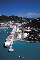 Aerial of 3 cruise ships at West Indian Co. dock Charlotte Amalie harbor. St. Thomas, US Virgin Islands Caribbean.