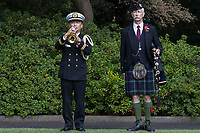 Bugler, Lieutenant Hiromi Watanabe (left) plays the Last Post with bagpiper,, Frank Hunter (right) in attendance during the Remembrance Sunday ceremony at the Hodogaya, Commonwealth War Graves Cemetery in Hodogaya, Yokohama, Kanagawa, Japan. Sunday November 11th 2018. The Hodagaya Cemetery holds the remains of more than 1500 servicemen and women, from the Commonwealth but also from Holland and the United States, who died as prisoners of war or during the Allied occupation of Japan. Each year officials from the British and Commonwealth embassies, the British Legion and the British Chamber of Commerce honour the dead at a ceremony in this beautiful cemetery. The year 2018 marks the centenary of the end of the First World War in 1918.