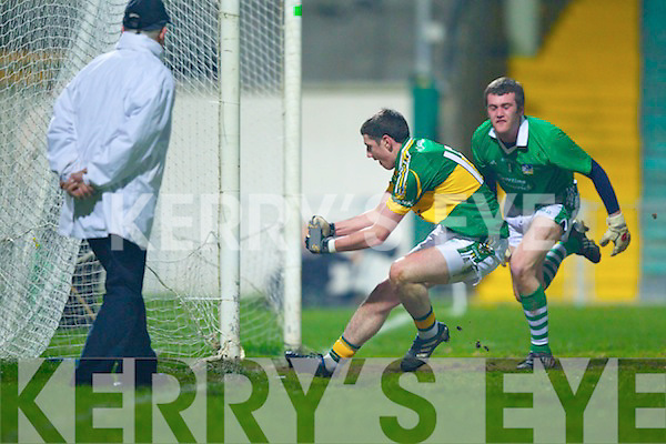 Brian Scanlon of Limerick is left hopeless as Paul Geaney punches the ball to score Kerry's 1st  goal in the Cadbury Munster GAA U21 football semi final held in The Gaelic Grounds on Wens 23rd.