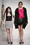 Senior fashion designer Abby Dubous, walks runway with model, at the close of the Pratt 2011 fashion show.