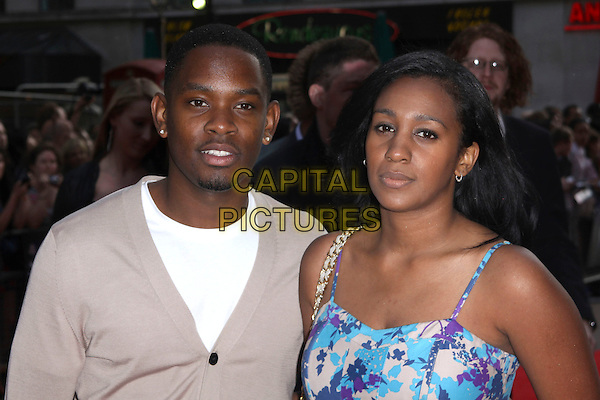 AML AMEEN & GUEST .World Film Premiere of '4,3,2,1' at the Empire, Leicester Square, London, England, UK, May 25th 2010 4321 4-3-2-1 arrivals portrait headshot beige white cardigan blue print .CAP/AH.©Adam Houghton/Capital Pictures.