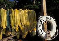 AJ2383, British Virgin Islands, Tortola, Caribbean, Virgin Islands, BVI, B.V.I., Yellow fishing nets hanging to dry at Brewer's Bay on the island of Tortola on the British Virgin Islands.