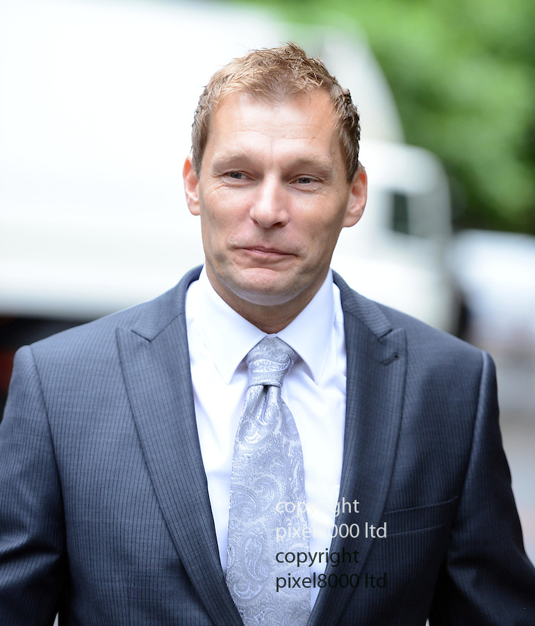 PC Simon Harwood arrives at Southwark Crown Court today 3.7.12.he was due to give evidence in his trial for the manslaughter of Big Issue seller Ian Tomlinson....Pic by Gavin Rodgers/Pixel 8000 Ltd