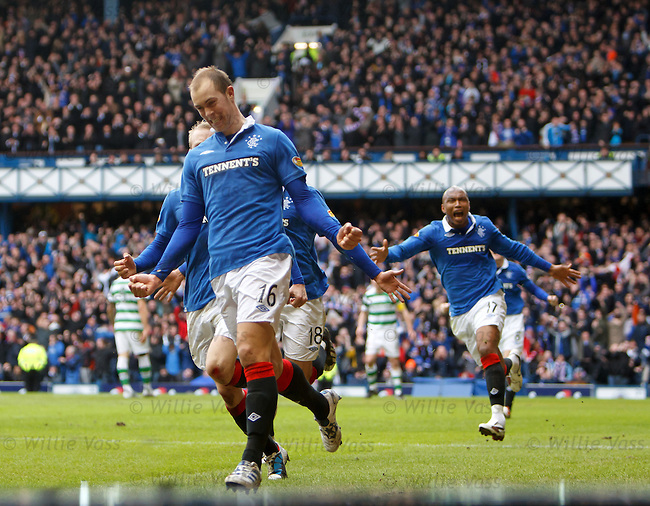 Steven Whittaker runs away to celebrate his penalty goal to the Rangers fans
