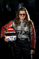 Sept. 19, 2010; Concord, NC, USA; NHRA funny car driver Ashley Force Hood poses for a portrait during the O'Reilly Auto Parts NHRA Nationals at zMax Dragway. Mandatory Credit: Mark J. Rebilas-