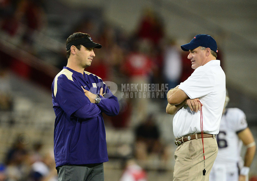 Oct. 20, 2012; Tucson, AZ, USA; Washington Huskies head coach Steve Sarkisian (left) talks with Arizona Wildcats head coach Rich Rodriguez prior to the game at Arizona Stadium. Arizona defeated Washington 52-17. Mandatory Credit: Mark J. Rebilas-USA TODAY Sports