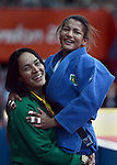 LONDON, ENGLAND - JULY 28:  Sarah Menezes of Brazil celebrates her gold medal with her coach after winning the women's Judo Final during Day 2 of the Swimming Finals as part of the London 2012 Olympic Games on July 28, 2012 at the Excel Center in London, England. (Photo by Donald Miralle)