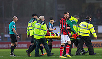 Peter Murphy of Morecambe  is stretchered off injured during the Sky Bet League 2 match between Wycombe Wanderers and Morecambe at Adams Park, High Wycombe, England on 2 January 2016. Photo by Andy Rowland / PRiME Media Images