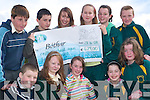 KIND KIDS: Presenting Maria McCormack from Bo?thar with a cheque on Monday morning, were the 6th class pupils of Gaelscoil Lios Tuathail after their fundraising hoops competition on Friday. Front l-r: Sea?n Mac Fionmhacain, Aoife Ni? Chonchuir, Tomina Ni? Sheighinn, Megan Ni? Bhambaire and Tara Ni? Liathain. Back l-r: Nicky de Barra, Eoin O hOrgain, Maria McCormack, Charlie-anne Breathnach, Amy Ni? Dheorain and Daryn O Lochlainn.   Copyright Kerry's Eye 2008