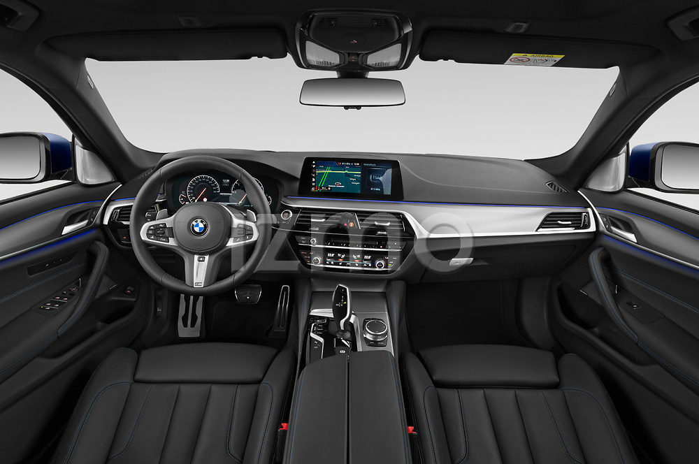 Stock photo of straight dashboard view of 2019 BMW 5-Series - 5 Door Wagon Dashboard