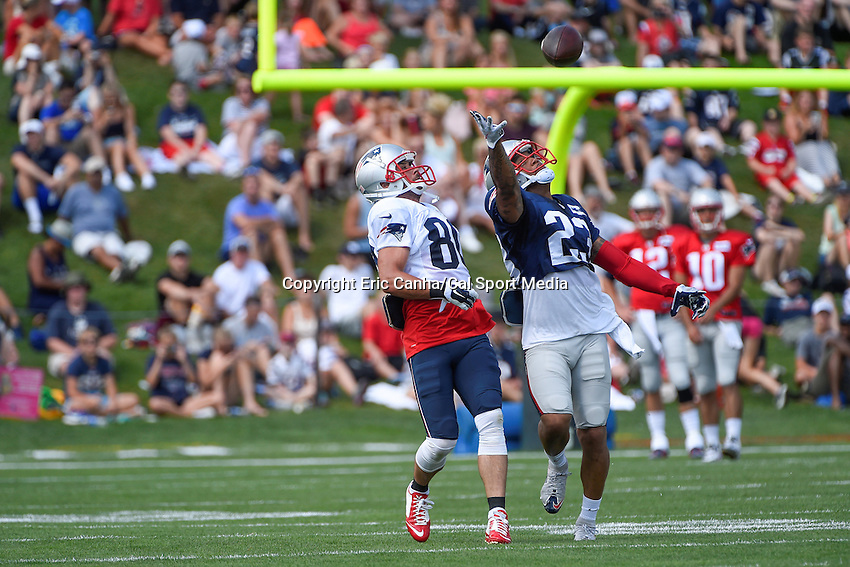 August 4, 2015: New England Patriots strong safety Patrick Chung (23) reaches out to intercept a pass to wide receiver Danny Amendola (80) during the New England Patriots training camp held on the practice field at Gillette Stadium, in Foxborough, Massachusetts. Eric Canha/CSM