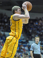 February 7, 2015 - Colorado Springs, Colorado, U.S. -  Wyoming guard, Jason McManamen #23, sets up to pass during an NCAA basketball game between the University of Wyoming Cowboys and the Air Force Academy Falcons at Clune Arena, U.S. Air Force Academy, Colorado Springs, Colorado.  Air Force soars to a 73-50 win over Wyoming.