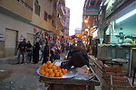 Young boy selling oranges in the Sharia Souk in Luxor.The town of Luxor occupies the eastern part of a great city of antiquity which the ancient Egytians called Waset and the Greeks named Thebes.
