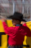 Zoomed close-ups of young cowboys / fans at the Tucson Rodeo competition in Tucson, Arizona.