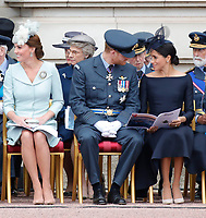 Catherine Duchess of Cambridge, Prince Harry, Meghan Duchess of Sussex<br /> The Royal Family watch RAF centenary fly-past at Buckingham Palace, The Mall, London, England on July 10, 2018.<br /> CAP/GOL<br /> &copy;GOL/Capital Pictures