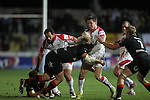 Dragons lock Robert Sidoli stops Ulster wing Craig Gilroy.Celtic League.Newport Gwent Dragons v Ulster.Rodney Parade.26.10.12.©Steve Pope