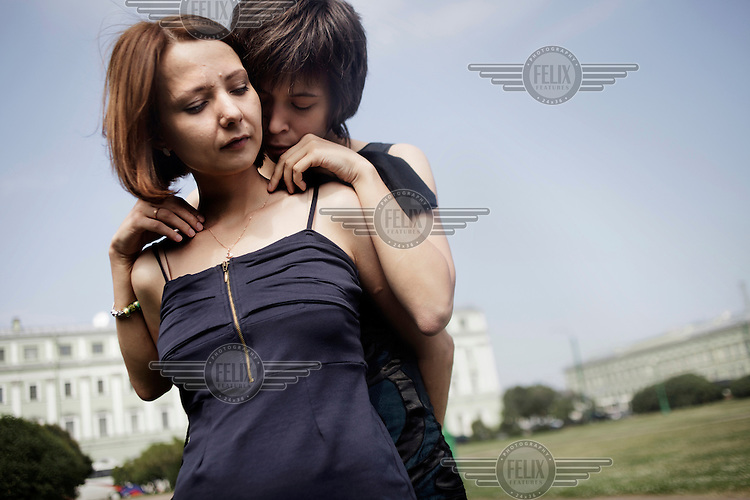 Yana Petrova (left) embraces her girlfriend Elena Davydova. On 30 June 2013, Russian President Vladimir Putin signed into law an ambiguous bill banning the 'propaganda of nontraditional sexual relations to minors'. The law met with widespread condemnation from human rights and LGBT groups. (MANDATORY CREDIT   photo: Mads Nissen/Panos Pictures /Felix Features)
