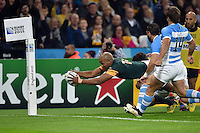 JP Pietersen of South Africa dives for the try-line. Rugby World Cup Bronze Final between South Africa and Argentina on October 30, 2015 at The Stadium, Queen Elizabeth Olympic Park in London, England. Photo by: Patrick Khachfe / Onside Images