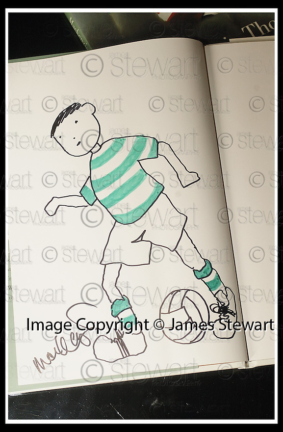 30/4/03          Copyright Pic : James Stewart                  .File Name : stewart-mackenzie thorpe 08.WORLD RENOWNED ARTIST MACKENZIE THORPE WITH THE TWO BOOKS HE IS AUCTIONING FOR CHARITY.. IN THE TWO BOoKS HE HAS HAND DRAWN A FOOTBALLER... ONE TO REPRESENT CELTIC AND THE OTHER RANGERS.....(see copy from George MAir).....James Stewart Photo Agency, 19 Carronlea Drive, Falkirk. FK2 8DN      Vat Reg No. 607 6932 25.Office : +44 (0)1324 570906     .Mobile : + 44 (0)7721 416997.Fax     :  +44 (0)1324 570906.E-mail : jim@jspa.co.uk.If you require further information then contact Jim Stewart on any of the numbers above.........