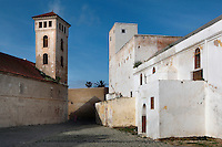 Church of the Assumption, built in the Manueline style of late Gothic architecture, 16th century on the left and Grand Mosque, 19th century, on the right, Portuguese Fortified city of Mazagan, El Jadida, Morocco. El Jadida, previously known as Mazagan (Portuguese: Mazag√£o), was seized in 1502 by the Portuguese, and they controlled this city until 1769. Picture by Manuel Cohen