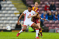 Chuks Aneke of MK Dons and Matt Kilgallon of Bradford City during the Sky Bet League 1 match between Bradford City and MK Dons at the Northern Commercial Stadium, Bradford, England on 24 April 2018. Photo by Thomas Gadd.