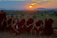 Monks enjoying the sunset at the Pyat That Gys temple Bagan Myanmar