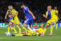 Diego Costa of Chelsea (centre) wins a penalty during the UEFA Champions League match between Chelsea and Maccabi Tel Aviv at Stamford Bridge, London, England on 16 September 2015. Photo by David Horn.