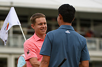Peter Malnati (USA) shakes hands with Brandon Wu (USA) during round 4 of the 2019 Houston Open, Golf Club of Houston, Houston, Texas, USA. 10/13/2019.<br /> Picture Ken Murray / Golffile.ie<br /> <br /> All photo usage must carry mandatory copyright credit (© Golffile | Ken Murray)