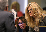Nevada Assembly Republicans Glenn Trowbridge, Victoria Seaman and Michele Fiore work on the Assembly floor at the Legislative Building in Carson City, Nev., on Friday, Feb. 13, 2015. <br /> Photo by Cathleen Allison