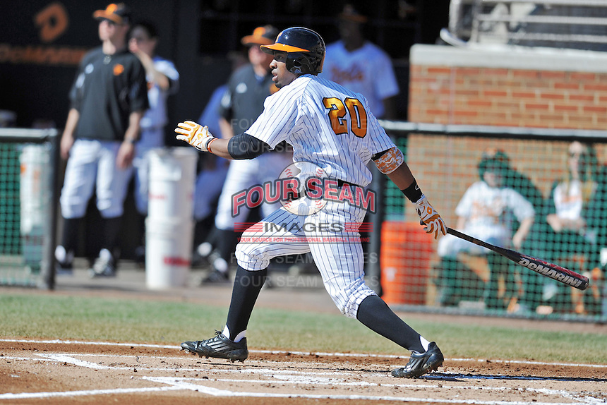 Left fielder Christin Stewart #20 of the Tennessee Volunteers swings at a pitch during a game against the UNLV Runnin' Rebels at Lindsey Nelson Stadium on February 22, 2014 in Knoxville, Tennessee. The Volunteers defeated the Rebels 5-4. (Tony Farlow/Four Seam Images)