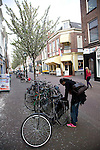 Locking up bicycle in street, Delft, Netherlands