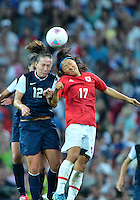August 09, 2012: Japan's Yuki Ogimi and United States' Lauren Cheney in action during Women's Football Final match at the Wembley Stadium on day thirteen in Wembley, England. USA defeat Japan 2-1 to win it's third consecutive Olympic gold medal in women's soccer. ..