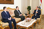 Egyptian President Abdel Fattah al-Sisi meets with his newly appointed Interior Minister, Mahmoud Tawfik (L) and former interior minister Magdi Abdel Ghaffar (C) after Egypt appointed a new government on Thursday at the Ittihadiya presidential palace in Cairo, Egypt, June 14, 2018. Photo by Egyptian President Office