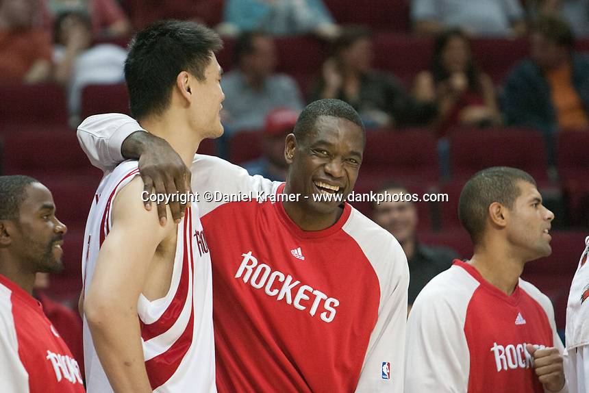Houston Rockets Yao Ming and Dikembe Mutombo goof around during the 2007 home game against the Memphis Grizzlies.