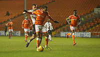 Blackpool's Nathan Delfouneso avoids the challenge from Charlton Athletic's Jason Pearce before shooting and scoring his sides second goal<br /> <br /> Photographer Stephen White/CameraSport<br /> <br /> The EFL Sky Bet League One - Blackpool v Charlton Athletic - Saturday 8th December 2018 - Bloomfield Road - Blackpool<br /> <br /> World Copyright &copy; 2018 CameraSport. All rights reserved. 43 Linden Ave. Countesthorpe. Leicester. England. LE8 5PG - Tel: +44 (0) 116 277 4147 - admin@camerasport.com - www.camerasport.com