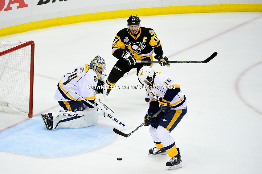 June 8, 2017: Nashville Predators defenseman P.K. Subban (76) clears the puck form the net coverd by goalie Juuse Saros (74) during game five of the National Hockey League Stanley Cup Finals between the Nashville Predators  and the Pittsburgh Penguins, held at PPG Paints Arena, in Pittsburgh, PA. Pittsburgh defeats Nashville 6-0 to lead the series 3-2. Eric Canha/CSM