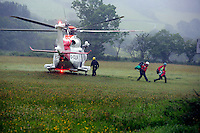 Pictured: A Coastguard helicopter lands in a field at Tafarn y Gerreg in Powys, Wales UK. Wednesday 29 June 2016<br />