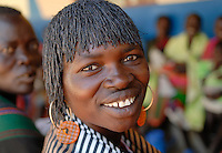 Uganda Karamoja , health station in Kotido , treatment of Karimojong a pastoral tribe  ,  woman with wig / kirchliches Krankenhaus in Kotido , Behandlung von Karimojong Frauen und ihren Babies, Frau mit Peruecke