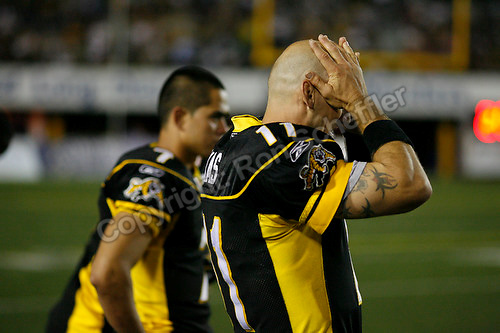 Jul 7, 2007; Hamilton, ON, CAN; Hamilton Tiger-Cats quarterback (11) Jason Maas rubs his head while standing on the sideline with quarterback (7) Timmy Chang during the 2007 season home opener against the Toronto Argonauts at Ivor Wynne Stadium. The Argos defeated the Tiger-Cats 30-5. Mandatory Credit: Ron Scheffler, Special to the Spectator.