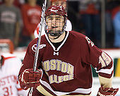 Chris Kreider (BC - 19) celebrates Brian Dumoulin's goal which made it 3-0 BC in the first period. - The visiting Boston College Eagles defeated the Boston University Terriers 3-2 to sweep their Hockey East series on Friday, January 21, 2011, at Agganis Arena in Boston, Massachusetts.