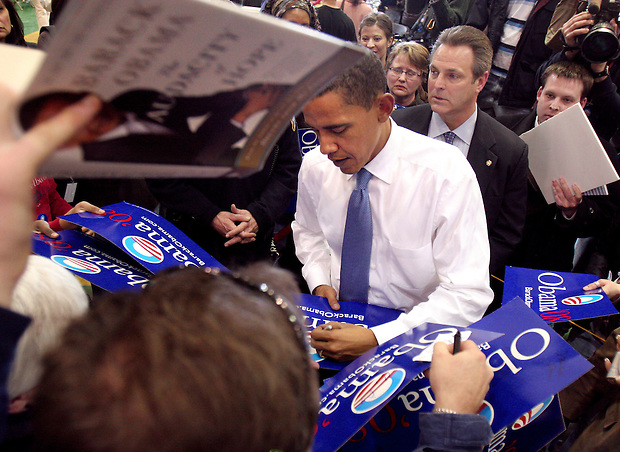 Sen. Barack Obama is besieged by autograph seekers following a town hall meeting Saturday, February 10, 2007 at Kennedy High School in Cedar Rapids, Iowa.  Earlier in the day, Obama formally announced his candidacy for President in Springfield, Illinois.