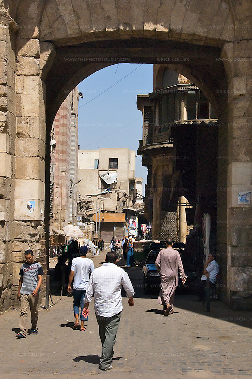 Cairo, Egypt -- Bab Zuwayla gate.  One of the three first gates installed around the historic walled city of Cairo, standing at the southern boundary of old Fatimid Cairo.  The two minarets atop this tower actually belong to the nearby Mosque of al-Mu'ayyad, which sits just inside this gate (on the left).  For a small fee, it is possible to climb the minarets for a spectacular view of old and new Cairo. © Rick Collier / RickCollier.com