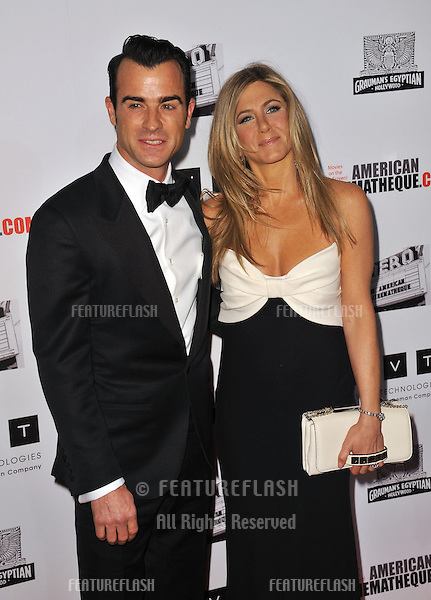 Jennifer Aniston & Justin Theroux at the 26th Annual American Cinematheque Awards Ceremony honoring actor Ben Stiller at the Beverly Hilton Hotel..November 15, 2012  Beverly Hills, CA.Picture: Paul Smith / Featureflash